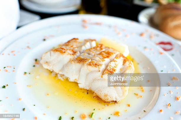 fillet of  seabass in lemon and butter sauce - bechamel sauce stock photos and pictures
