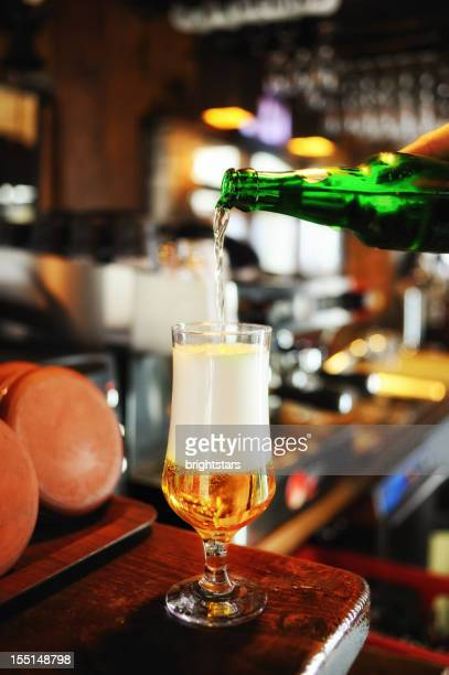 Filling a beer glass on the bar counter