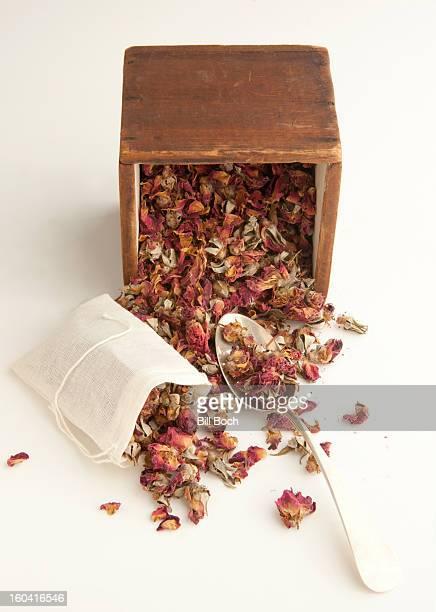 Filling a dried roses potpourri sachet bag
