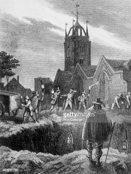 Filling a mass grave at night during the Plague of London, c 1665. Showing a group of men with torches in a churchyard, preparing to empty the...