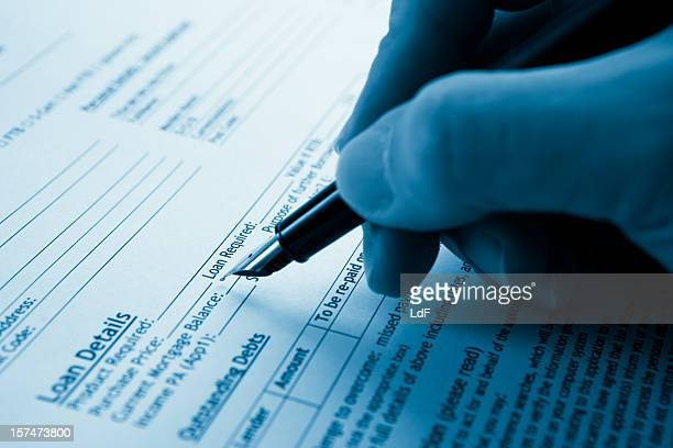 filling a mortgage form - mortgage document stock pictures, royalty-free photos & images