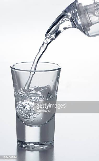 filling a shot glass - vodka stock pictures, royalty-free photos & images