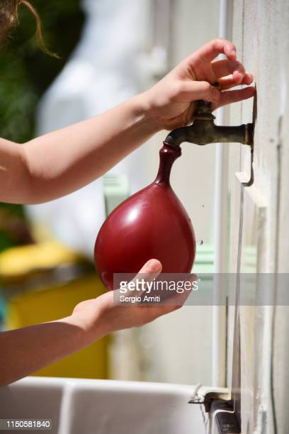 Filling a water balloon