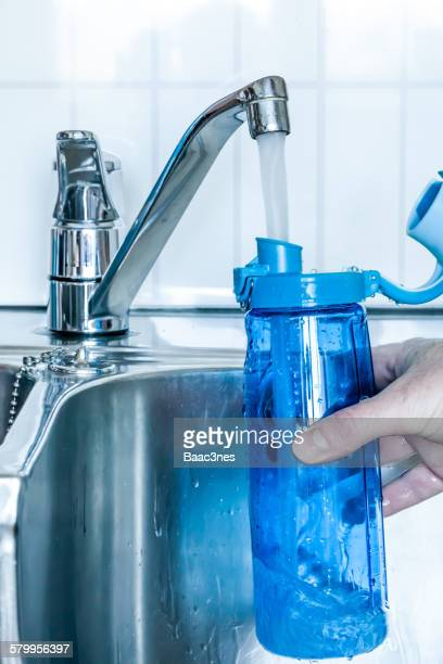 Filling cold water in a drinking bottle