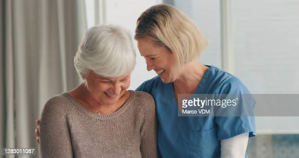 filling her golden years with a good laugh - 65 69 years stock pictures, royalty-free photos & images