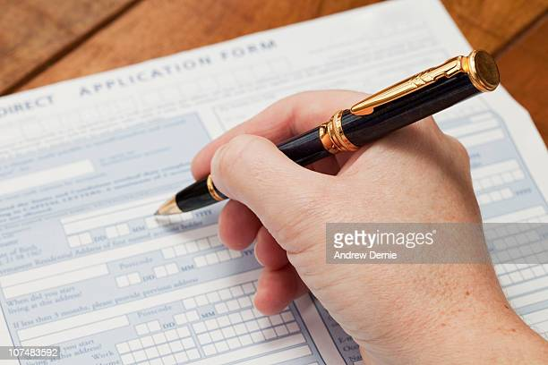 filling in forms - andrew dernie stock pictures, royalty-free photos & images