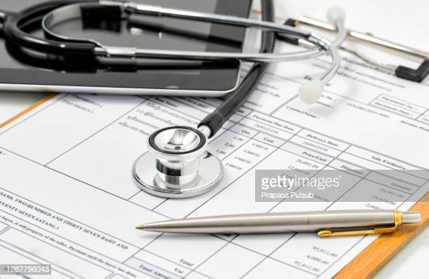 filling medical form, document, stethoscope - healthcare stock pictures, royalty-free photos & images
