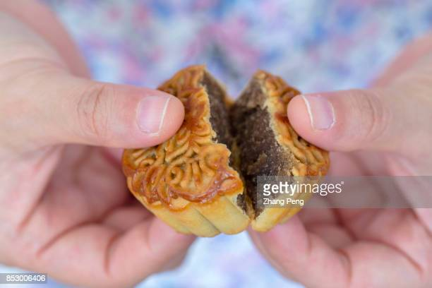 Filling of a moon cake arranged for photography Midautumn festival is a Chinese traditional holiday and the moon cake is the main folk food of the...