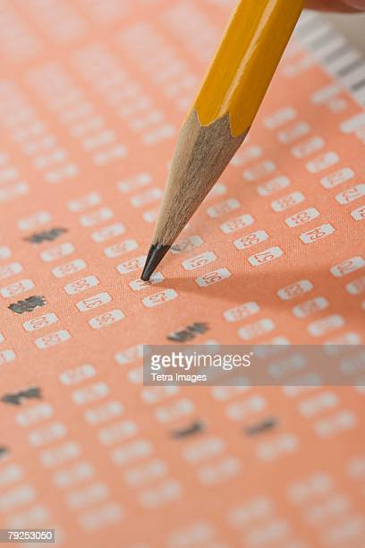 filling out a lottery ticket - lotterytickets stock pictures, royalty-free photos & images