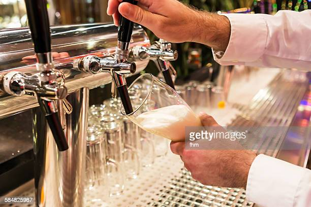 Filling up a glass with beer