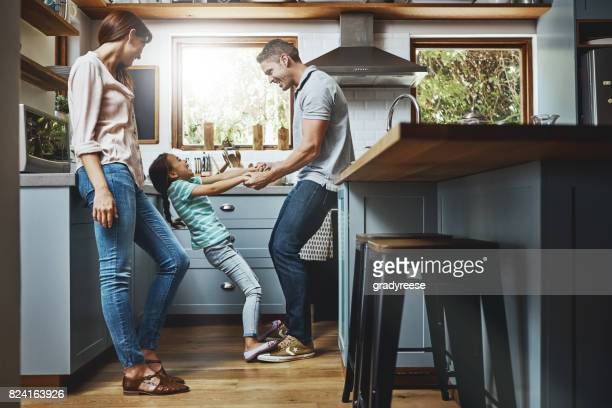 filling up their lives with some fun times - family home stock photos and pictures
