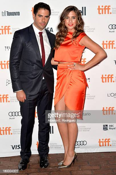 Fillmmaker Eli Roth and actress Lorenza Izzo attend the The Green Inferno premiere during the 2013 Toronto International Film Festival at Ryerson...