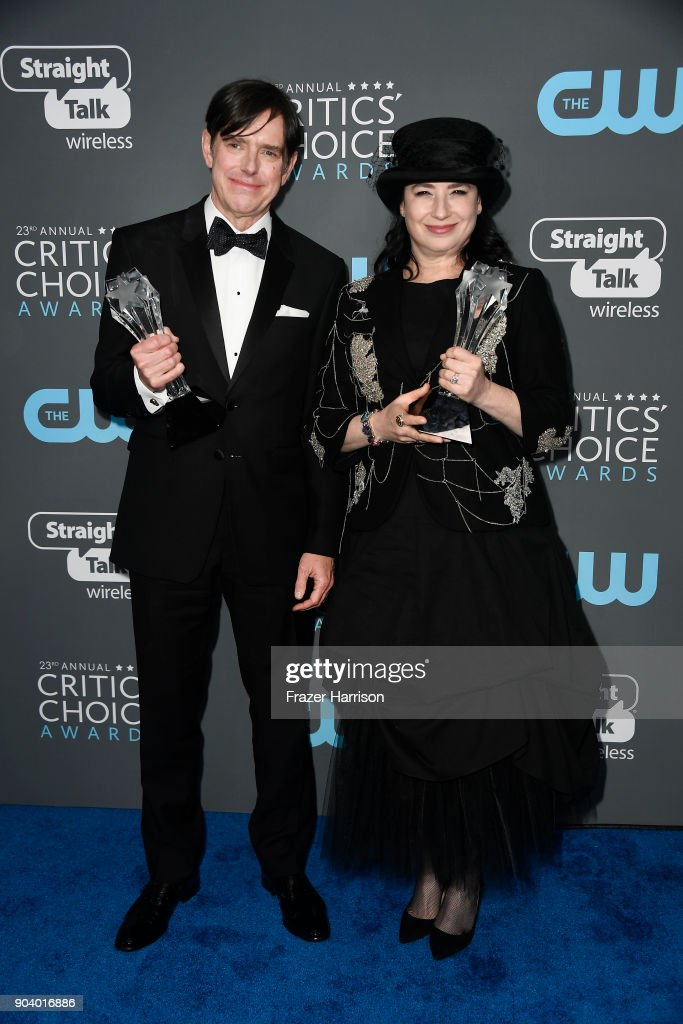 Fillmmakers Dan Palladino (L) and Amy Sherman-Palladino, recipients of the Best Comedy Series award for 'The Marvelous Mrs. Maisel', pose in the press room during The 23rd Annual Critics' Choice Awards at Barker Hangar on January 11, 2018 in Santa Monica, California.