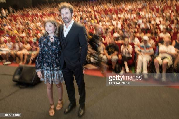 US film actor director and producer Casey Affleck and US actress Anna Pniowsky pose for photographers after the presentation of their film ''Light of...