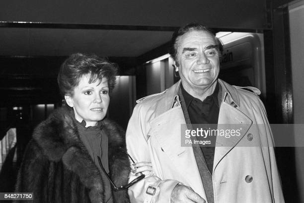 Film actor Ernest Borgnine and his wife Tove arriving at Heathrow Airport before flying on to Sun City South Africa for a ProAm golf tournament