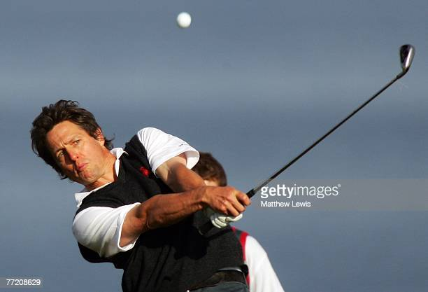Film actor Hugh Grant plays his second shot on the fourth hole during the third round of The Alfred Dunhill Links Championship at Kingsbarns Golf...