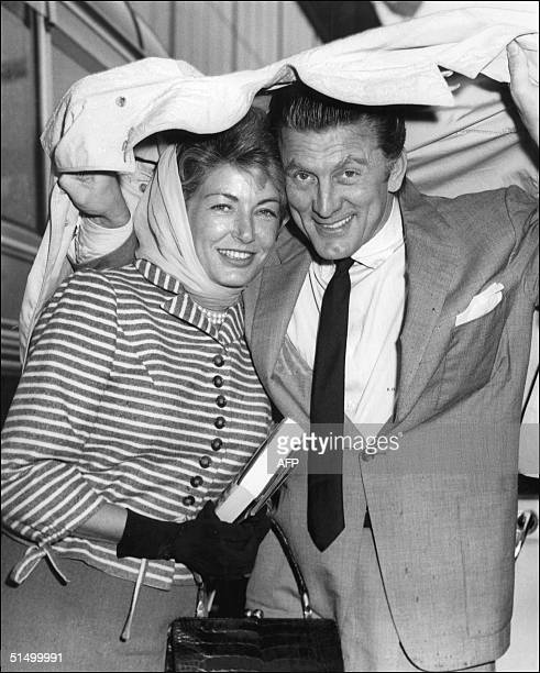 Film actor Kirk Douglas and his wife Anne pose for photographers at the London airport 18 August 1958 Douglas born in Amsterdam Netherlands made his...
