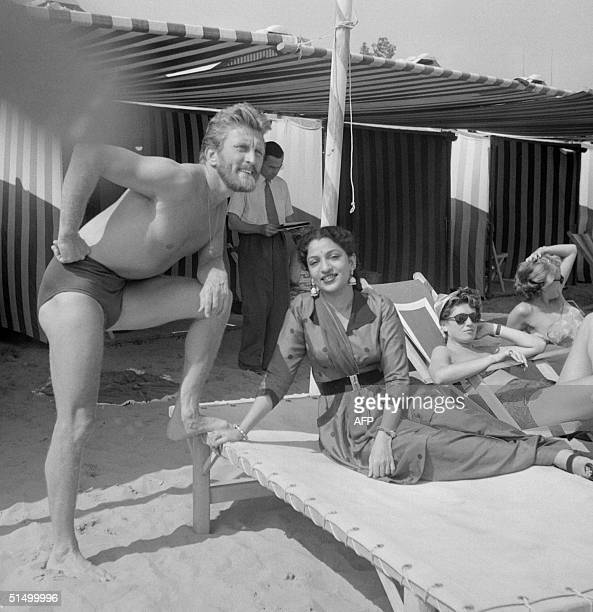 Film actor Kirk Douglas and the Indian actress Mehtab rest at the Lido beach 01 September 1953 during the Venice Film Festival Douglas born in...
