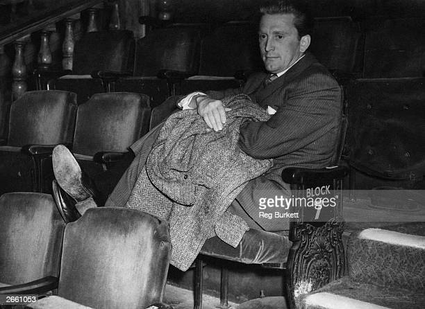 Film actor Kirk Douglas watching rehearsals for a Royal Film performance at the Empire Leicester Square