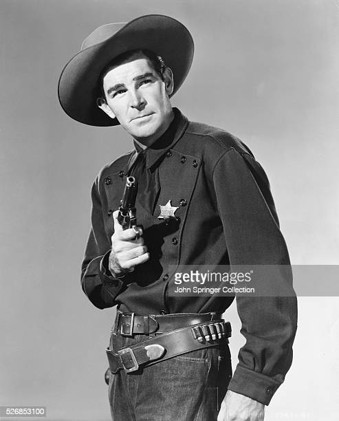 Film Actor Rod Cameron in Sheriff Costume Holding Revolver