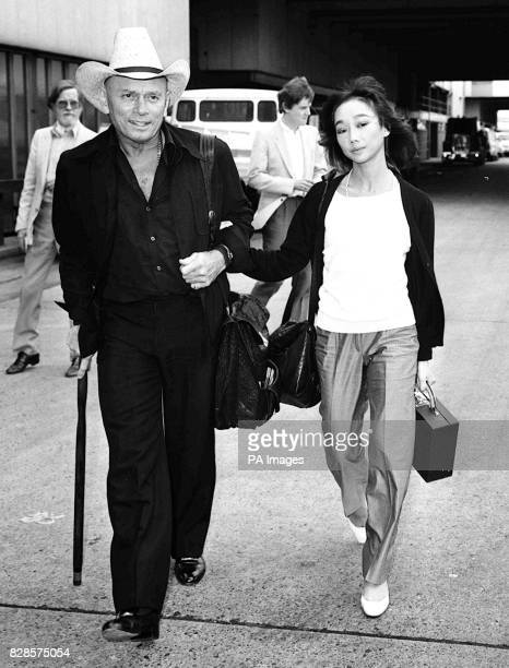 Film actor Yul Brynner with his wife of two months 25yearold Oriental dancer Kathy Lee arrive at Heathrow Airport from Los Angeles Yul married Kathy...