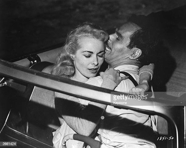 US film actors Janet Leigh and Charlton Heston get steamy in their car in a scene from the UniversalInternational film 'Touch of Evil' directed by...