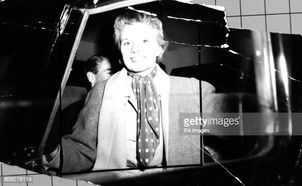 Film actress Ann Todd wears a gay polkadot muffler as she arrives at London Airport on April 20th 1954 by BEA from Rome where she has spent the...