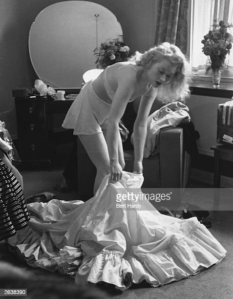 Film actress Christine Norden changes her outfit before making 'personal appearances' in Sheffield Original Publication Picture Post 4530 Personal...