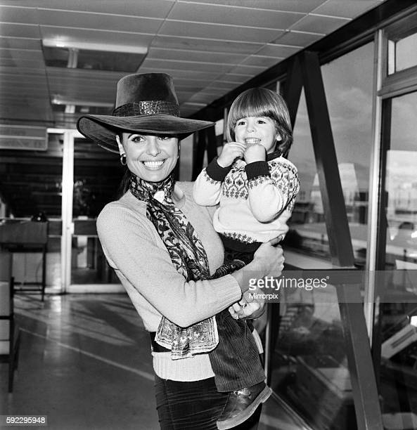 Film actress Dahlia Lavi and her 2 year old son Rouven pictured together at London Airport today before leaving to spend Christmas with her mother in...