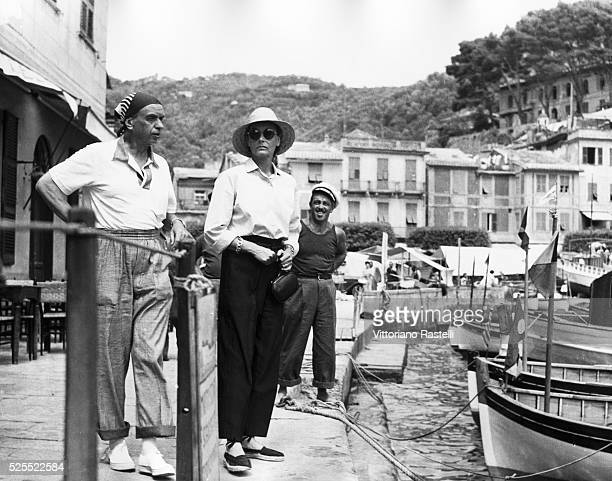 Film actress Greta Garbo strolling with a friend along the sea front in Portofino Italy