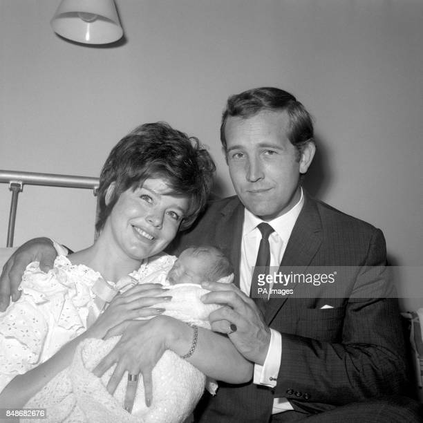 Film actress Janet Munro gently clasps her baby daughter given the temporary name 'New' because no name has yet been chosen with her husband actor...