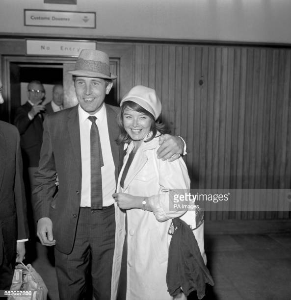 Film actress Janet Munro is affectionately greeted by husband Ian Hendry on his arrival by KLM from Nice