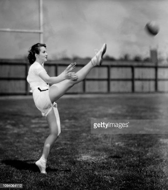 US film actress Jayne Regan kicks a ball in 1936 Jayne Regan's dancing ability helps her tremendously when she is called upon to punt in 'Pigskin...