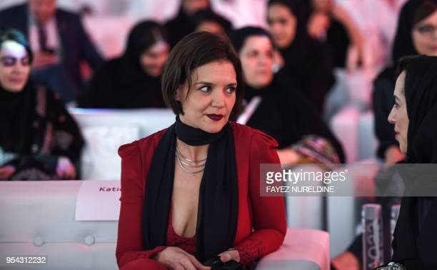 US film actress Katie Holmes speaks to a Saudi participant as she attends the Quality of Life Program 2020 conference in the capital Riyadh on May 3...