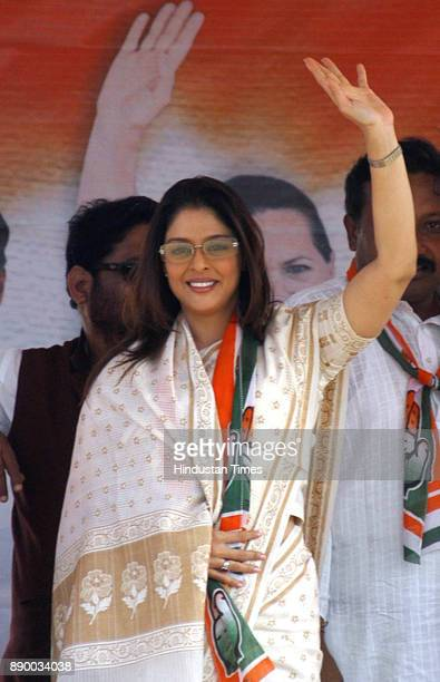 Film actress Nagma waves to crowd duing UPA chairperson Sonia Gandhi's election rally in Dabhoi in Vadodra