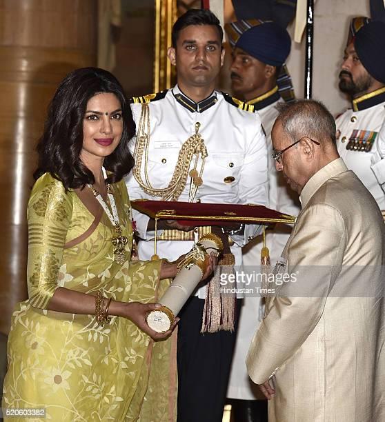 Film actress Priyanka Chopra receiving Padma Shri award from President Pranab Mukherjee during Civil Investiture Ceremony at Rashtrapati Bhawan on...