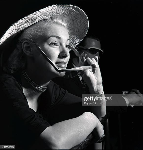 Film actress Susan Shaw wearing a straw hat at Telekinema South Bank 1951
