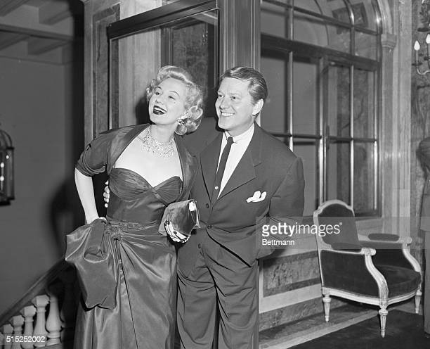 Film actress Virginia Mayo is escorted by her husband Michael O'Shea to the Fan Ball held in aid of the Children's Memorial Cancer Fund at the Plaza...