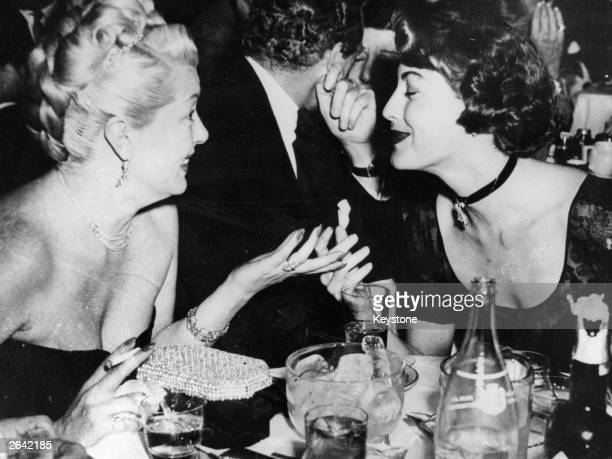 US film actresses Lana Turner and Ava Gardner dining in a Hollywood restaurant Original Publication People Disc HP0269