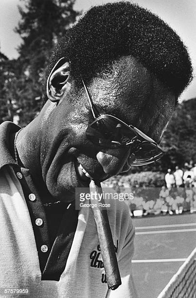 Film and comedian star Bill Cosby takes a cigar break during a 1980 benefit tennis tournament at the Playboy Mansion in Beverly Hills California