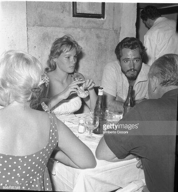 Film and television actress Ursula Andress with the director John Derek in a restaurant in Via Veneto Rome in 1958