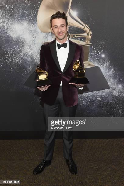 Film composer Justin Hurwitz winner of Best Compilation Soundtrack for Visual Media for 'La La Land' poses backstage at the Premiere Ceremony during...