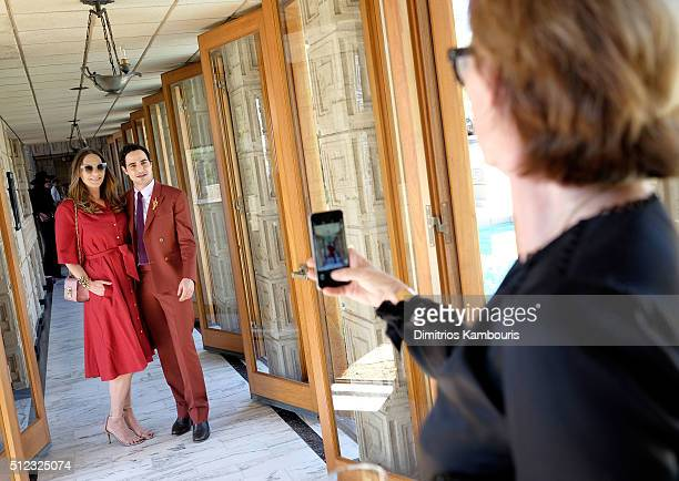 Film costume designer Jacqui Getty and fashion designer Zac Posen pose for a photo at the MAC Cosmetics Zac Posen luncheon at the Ennis House hosted...