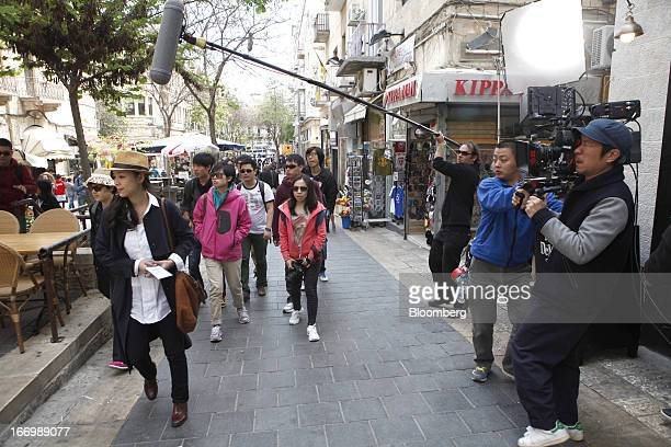A film crew from Chuan Films shoots footage of Zhang Jingchu a Chinese actress left on the set of 'The Old Cinderella' at the Ben Yehuda pedestrian...