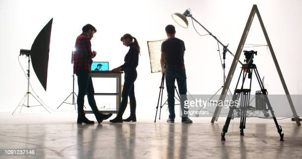 film crew in the studio - cinematographer stock pictures, royalty-free photos & images