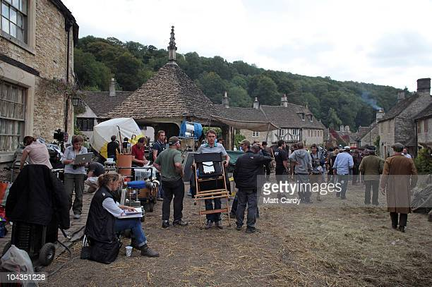 Film crew members wait for filming to continue on the set of 'War Horse' which is currently being filmed in Castle Combe on September 22 2010 near...
