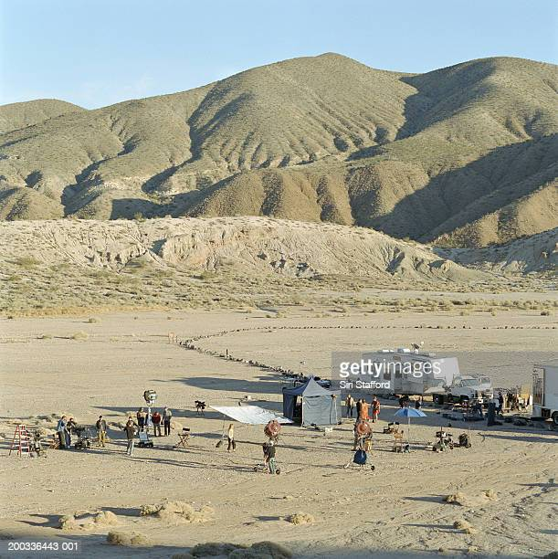 film crew on location in desert, elevated view - film crew stock photos and pictures