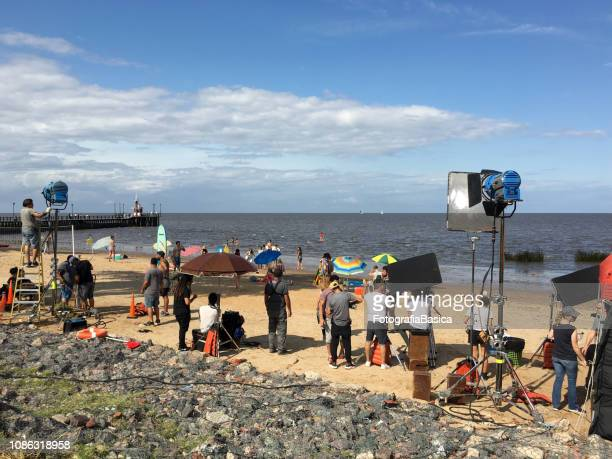 film crew on location shooting advertisement - film set stock pictures, royalty-free photos & images