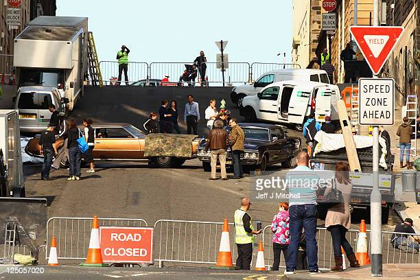 Film crew prepare a scene on the streets of Glasgow for the Halle Berry movie Cloud Atlas on September 15 2011 in Glasgow Scotland The city council...