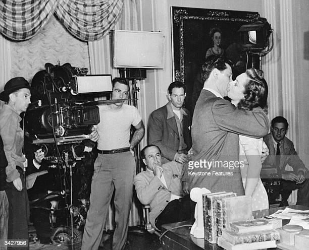 A film crew shoot a kissing scene at the Warner Brothers Film Studios in Hollywood